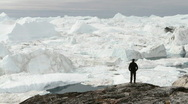 Stock Video Footage of Tourist walking in front of glacier