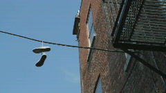 Sneakers hanging from wire. Stock Footage