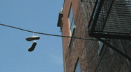 Stock Video Footage of Sneakers hanging from wire.