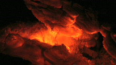 Fire Burns in Glowing Hot Orange and Yellow Fiery Coals Stock Footage