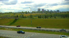 Deerfoot trail traffic calgary city skyline clouds time lapse Stock Footage