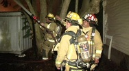 Stock Video Footage of Firemen Stand Back And Hose House
