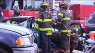 Firemen Use Jaws of Life to Remove Vehicle Roof Stock Footage