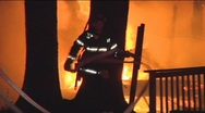 Firemen Prepare Hose to Extinguish Large Fire Stock Footage