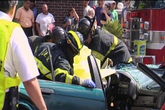 Battalion Chief Supervises the Rescue of Car Accident Victim Stock Footage