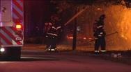 CU Firemen Hose Flames from Street Stock Footage