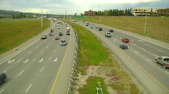 Deerfoot trail traffic both directions overhead view time lapse Stock Footage