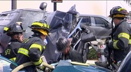 Firemen Work to Release Victim from Car Accident Stock Footage
