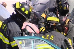 CU Firemen Work to Release Victim from Car Accident Stock Footage
