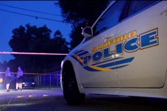 Parked Police Car Cops in Background Stock Footage