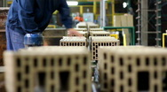 Workers at the factory making blocks and bricks Stock Footage
