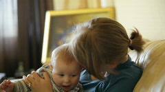 Baby boy and mother in living room - stock footage