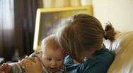 Baby boy and mother in living room Stock Footage