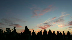 Ss revelers silhouetted against sunset Stock Footage