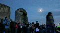 ss revellers around Stonehenge evening Footage