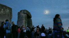 Ss revellers around Stonehenge evening Stock Footage