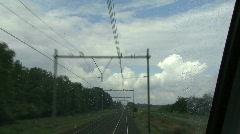 Train moving towards beautiful cloudscape Stock Footage