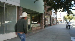 Empty store front, cowboy walking old town Stock Footage