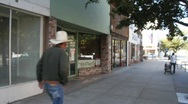 Empty store front, cowboy Stock Footage