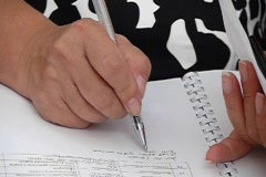 Writing in notebook Stock Footage