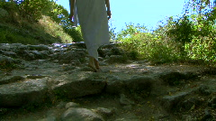 girl goes on ancient road Stock Footage
