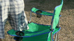 man sitting in lawn chair - stock footage