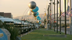 Big Balloons In Front of a Car Truck Dealership With Trucks Lined up Stock Footage