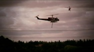 Stock Video Footage of Helicopter fire drop and bank