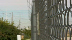 Danger High Voltage on a Fence Surrounded by barbed Wire 2 Stock Footage
