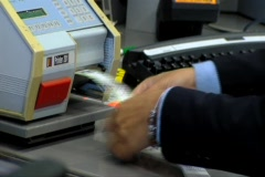 printing suitcase label at check in desk - stock footage