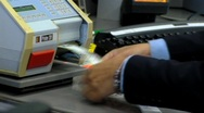Printing suitcase label at check in desk Stock Footage