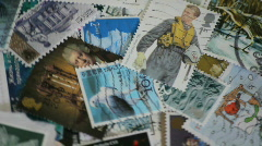 postage stamps rotating - stock footage