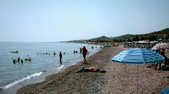 People on a beach in sunny day in Rome, Italy. Stock Footage