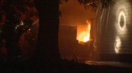Firemen Hose Flaming House at Night Stock Footage