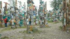 Sign post forest Watson Lake Canada P HD 7695 Stock Footage