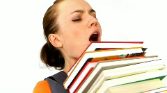 Teenage girl struggling with stack of books - stock footage