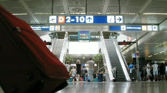Escalators, many people in an airport hall. Stock Footage