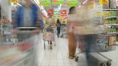 People with carts in a supermarket Ashan in Moscow, Russia. - stock footage