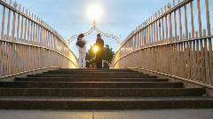 People on Ha'penny Bridge in Dublin, Ireland. Stock Footage