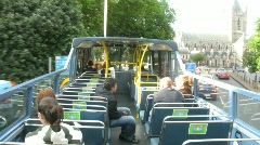 Tourists go by the two-storeyed bus on a city, Dublin, Ireland. - stock footage