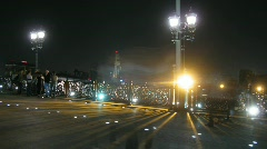 People walk on Patriarshy bridge at night and statue The Peter the Great Statue Stock Footage