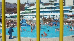 View on an aquapark through a lattice, outdoor in Sochi, Russia. Stock Footage
