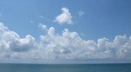 Stock Video Footage of Sunny day on the sea, clouds move on the sky.