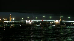 Drawbridge in St-Petersburg at night, on river ships float. Stock Footage