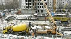 Work on a building site: workers, the crane, cement mixer in Moscow, Russia. Stock Footage