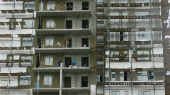 Under construction house: workers on each floor. Stock Footage
