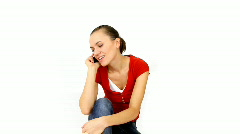 Woman sitting with telephone,  isolated over white background Stock Footage