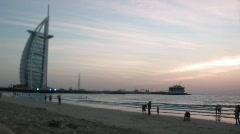The grand sail shaped Burj al Arab Hotel taken and evening beach in Dubai. Stock Footage