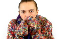 Woman in sweater embrace herself and shiver Stock Footage