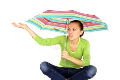 Happy young woman sitting with color umbrella,  isolated on white  Stock Footage